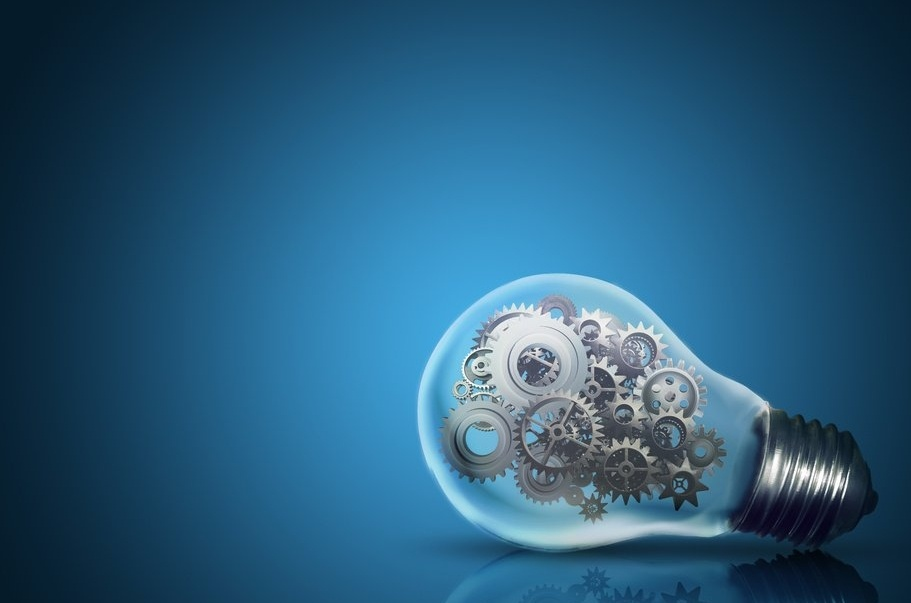 Close up of light bulb with gear mechanism inside isolated on dark blue background-879202-edited.jpeg